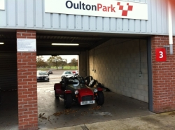 Caterham 7 in pit garage at Oulton Park